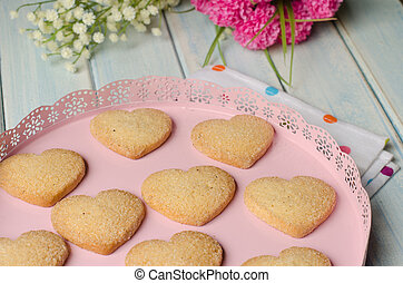 Heart-shaped butter cookies - Pink tray with butter and...