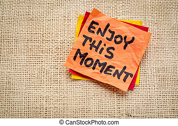 enjoy this moment reminder or advice - handwriting on a...