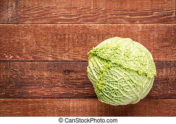 savoy cabbage on rustic wood