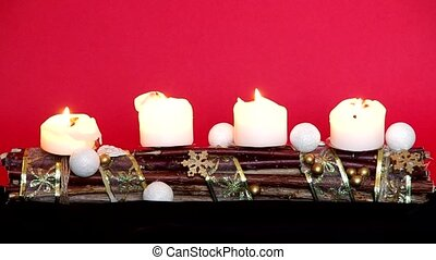 Advent wreath with white candles on a red background