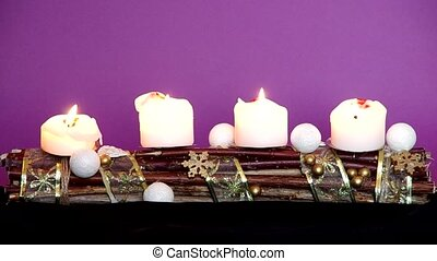 Advent wreath with white candles on a violet background