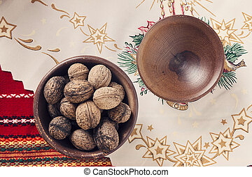 Walnuts In A Wooden Bowl .