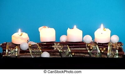Advent wreath with white candles on a blue background
