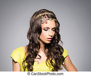 Gorgeous, sensual brunette wearing golden luxury coronet...