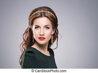 Portrait of gorgeous brunette wearing luxury golden coronet...