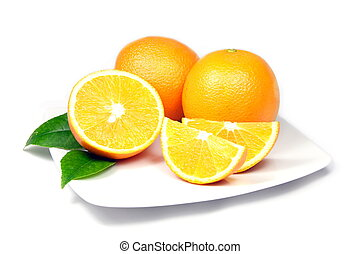 Oranges on Plate - Two Single and One Sliced Ripe Oranges on...