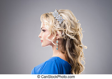 Side view of beautiful, young lady wearing sapphire coronet...