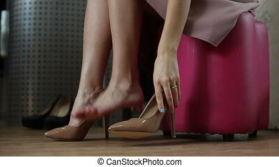Woman trying new shoes - Girl trying on new shoes in a store