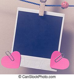 Blank instant photo and small red paper heart - Blank...