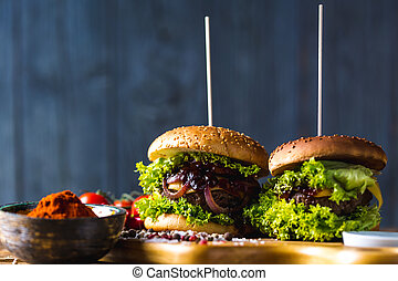 Hot grilling meat, traditional American burgers