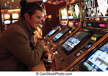 Slot casino - Man playing in slot casino in Las Vegas