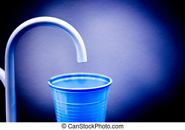 Dentists dental rinse tap and cup in clinic photo.