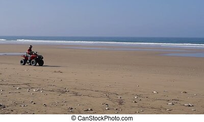 atv on beach, marocco