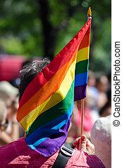 Gay rainbow flag - Man holding a gay rainbow flag