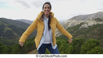 Fun young woman on a mountain - Fun attractive young woman...