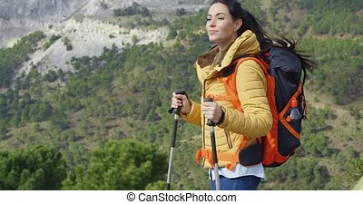 Young woman hiker enjoying the view - Young woman hiker with...