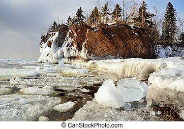 Ice and Rocky Shoreline in Winter - The Icy Shoreline of...