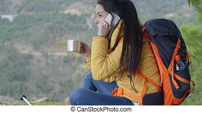 Happy female hiker on phone - Beautiful laughing Caucasian...