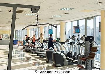 Training apparatus in a gym hall.