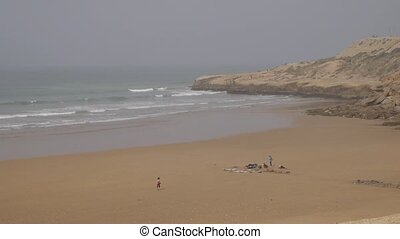 surfers on beach, Morocoo