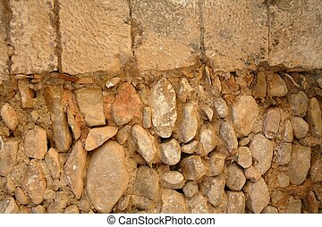 Golden masonry stone wall from old building