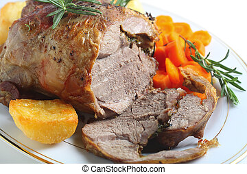 Roast boneless lamb - A serving plate with a joint of...