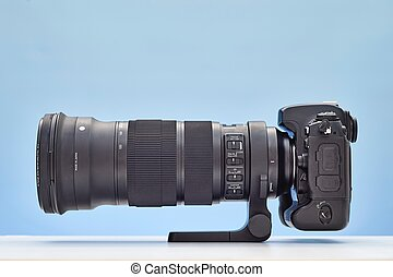 Telephoto Lens - A studio photo of a modern telephoto zoom...