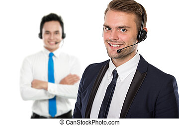 Employee of call center with a headset on - A portrait of a...