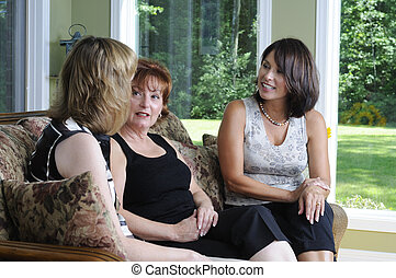 Good Friends - Three Women Having A Conversation At A Party