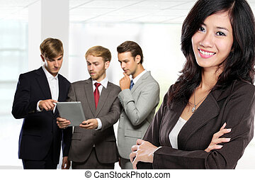 Young asian businesswoman, with her team behind isolated in whit