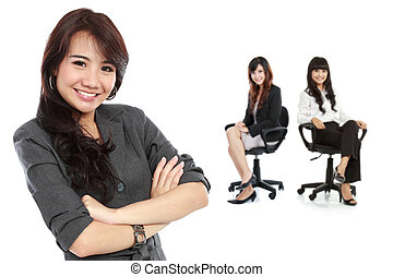 Young asian businesswoman, with her team behind. isolated in whi