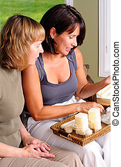 Middle Age Women - Two Middle Age Women At A Home Candle...