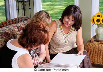 Photo Album - Middle Age Woman Showing Her Families Photo...