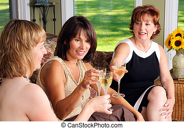 Wine - Three Middle Age Women Friends Toasting With White...