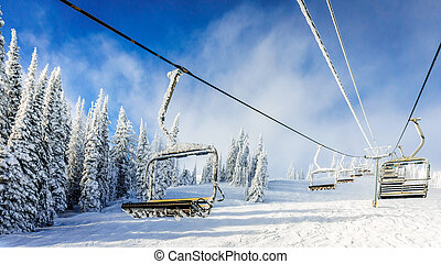 Empty, snow and ice covered ski lift - Empty, snow and ice...