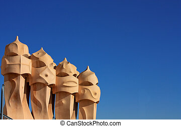Symbol of Barcelona. Chimneys, Gaudi - On the terrace of the...
