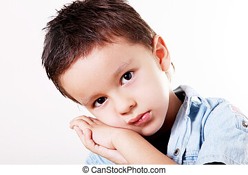 Child sad - child support for his face in his hands with sad...