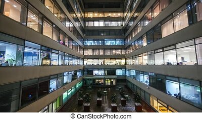 Time lapse of busy city office workers together in large...