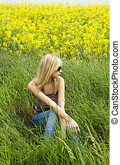 blond girl on the grass - very cute blond woman sitting down...
