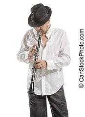 homem, em, chapéu, tocando, clarinete,