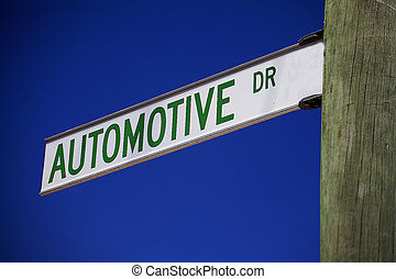 Automotive - A street sign pointing to Automotive Drive