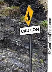 caution rock fall sign on Ballybunion beach
