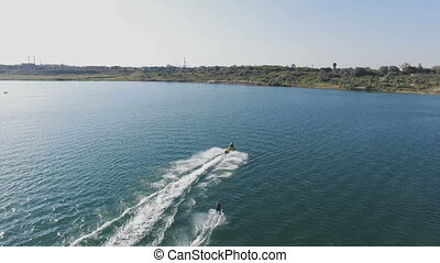 Jet Ski Riding On The River With Water skiing - Jet Ski...