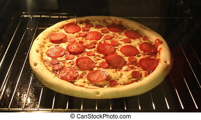 Time-Lapse of Pizza baking in the o - A time-lapse video of...