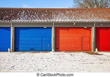 blue and red Garage Doors in Snow