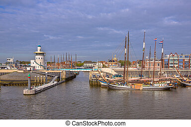 Entrance Harlingen harbor on the wadden sea - Harbor of...