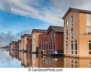 Modern Houses on the Water Front in a row