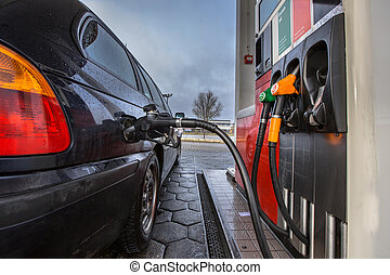 Gas station car refueling - Gas pump fill at a gas station...