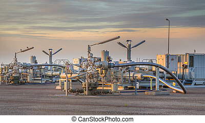 Natural gas production plant in the Waddensea area with pipe...