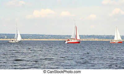 Sailing boats on the sea and blue sky at sunny day